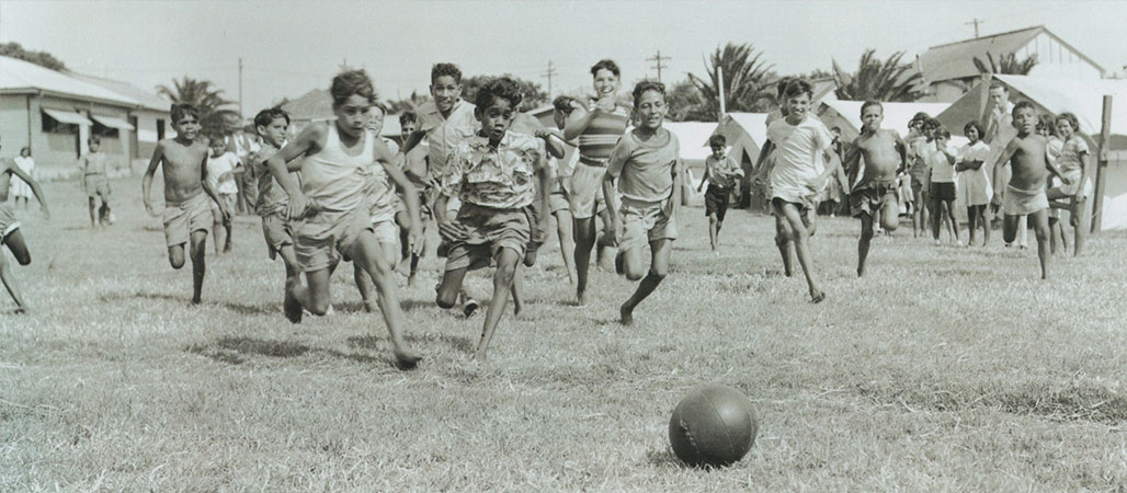 Group of young people playing soccer